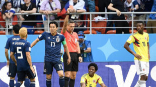 Slovenian referee Damir Skomina shows a red card to Colombia's...