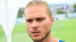 Iceland's midfielder Rurik Gislason speaks to the media.