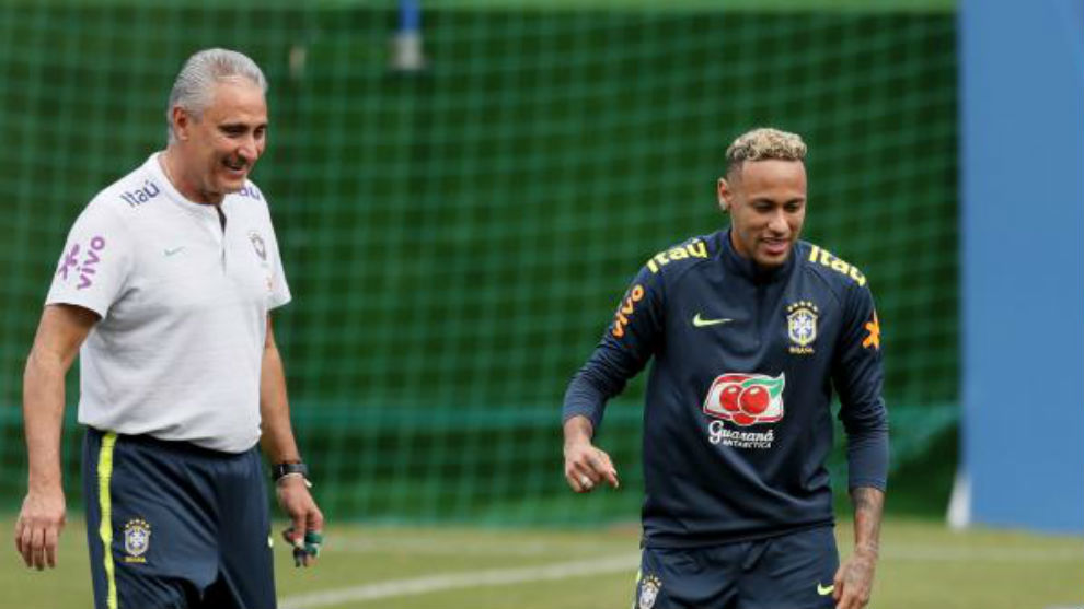 Brazil's coach Tite and Brazil's forward Neymar are seen during