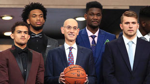 Commissioner Adam Silver poses with Trae Young, Marvin Bagley III,...