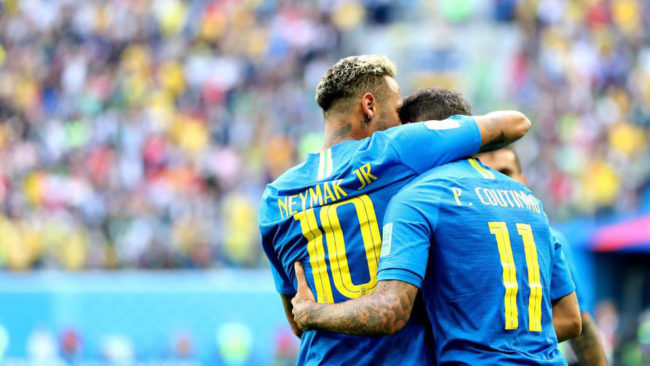 Philippe Coutinho celebrates scoring the 1-0 with Neymar during the...