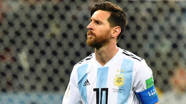 Lionel Messi reacts at the end of the match between Argentina and...