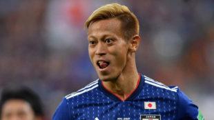 Keisuke Honda celebrates after scoring his team's second goal during...