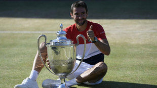 Marin Cilic poses with the trophy after winning against Novak Djokovic