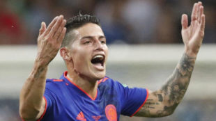 James Rodriguez celebrates the 1-0 lead during the match between...