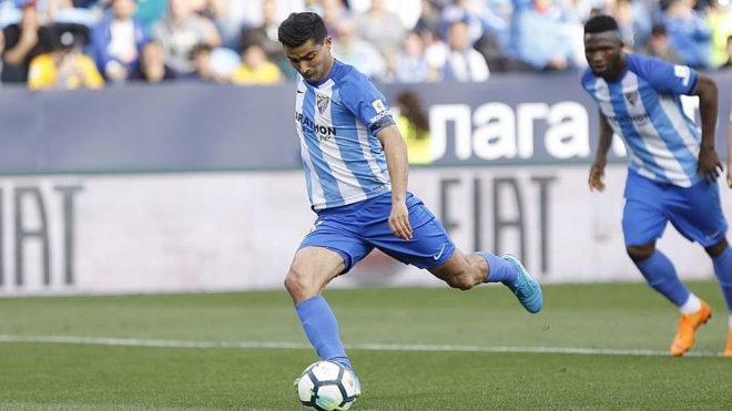 Chory dispara a puerta en un partido con la camiseta del Málaga.