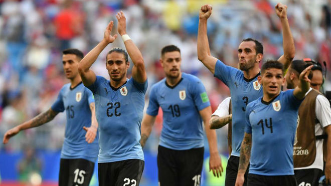 Uruguay's players acknowledge fans at the end of the match between...