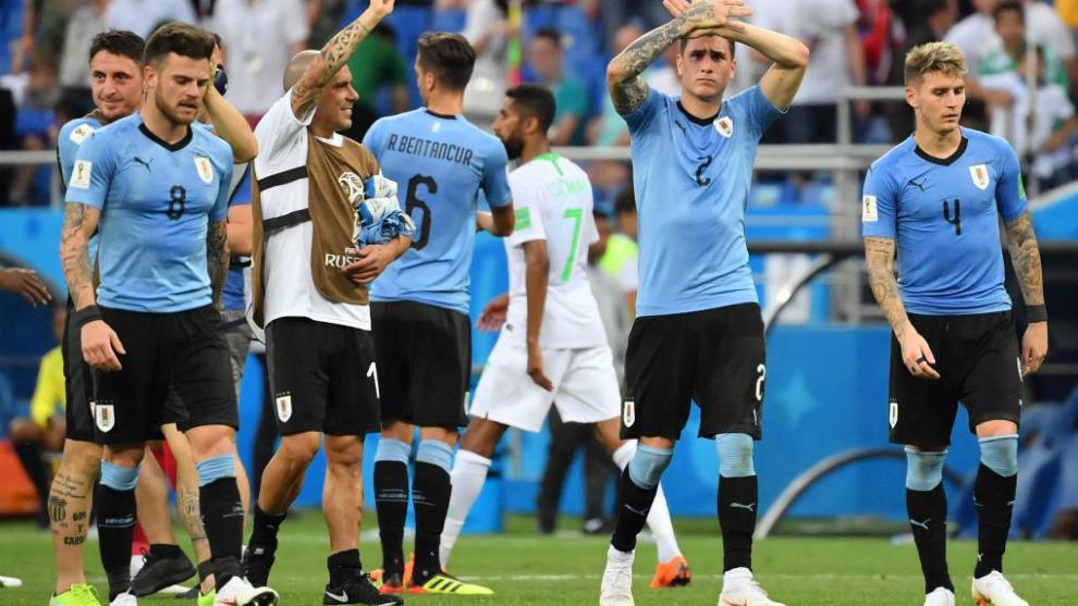 Jugadores de la selección de Uruguay celebran su triunfo ante Rusia