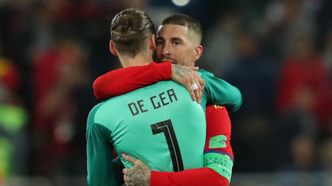 Sergio Ramos and David de Gea react after the match between Spain and...