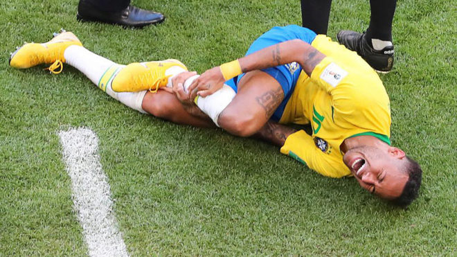 Brazil's forward Neymar falls on the ground during the match between...