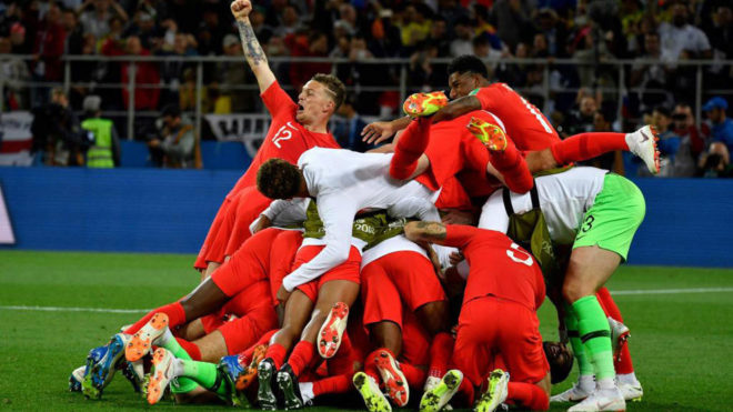 England's players celebrate winning the penalty shootout at the end of...