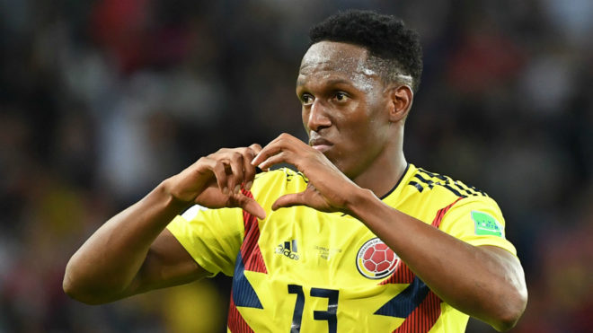 Yerry Mina celebrates after scoring the equalizer during the match...