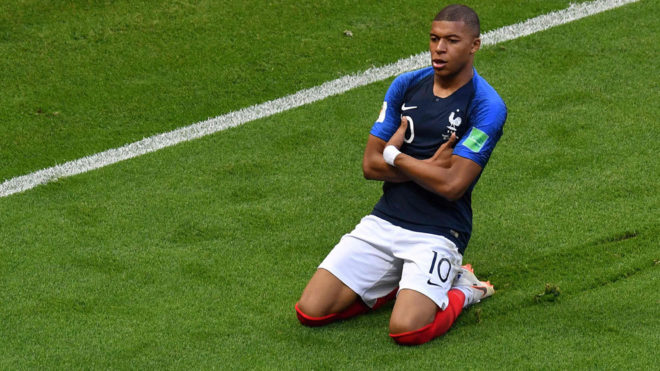 Kylian Mbappe celebrates after scoring during the match between France...
