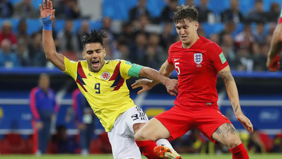 John Stones of England in action against Radamel Falcao of Colombia.