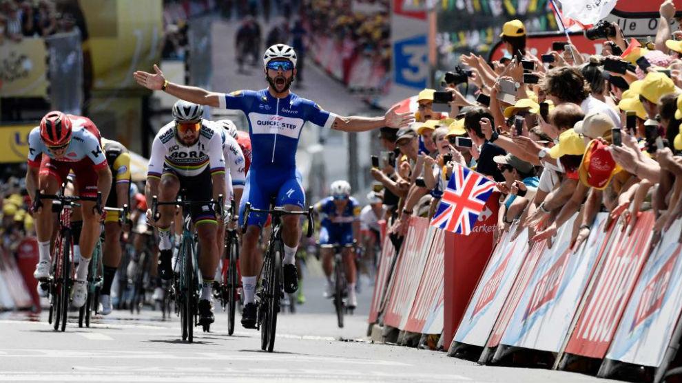 Gaviria celebrates as he crosses the finish line ahead of Peter Sagan.