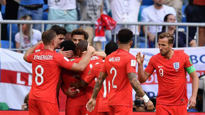 England's players celebrate their second goal.