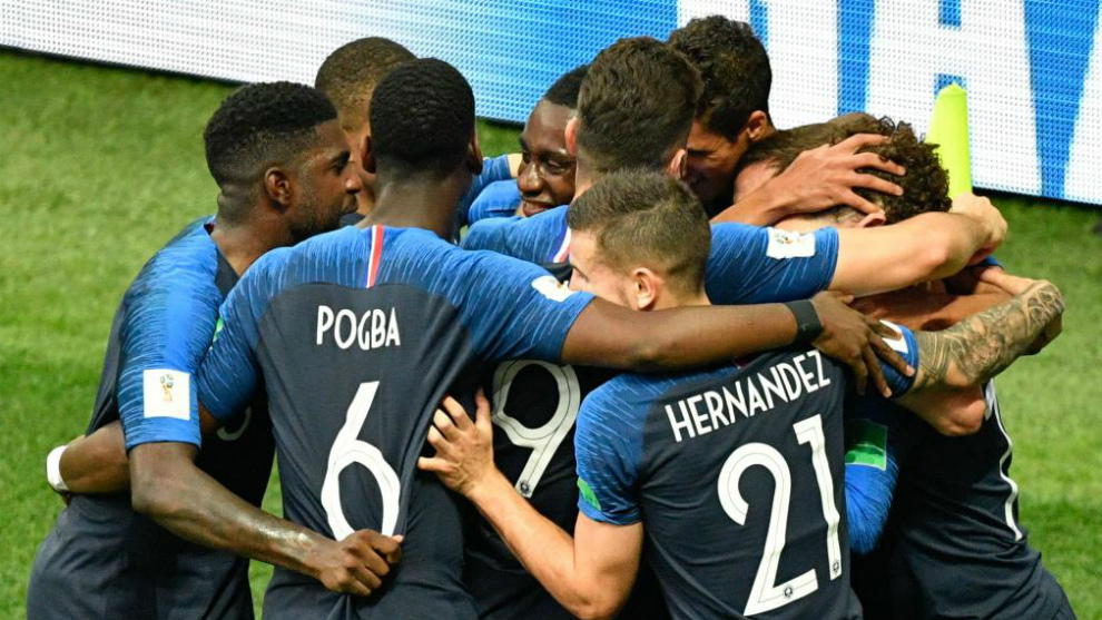 France's team players celebrate a goal.