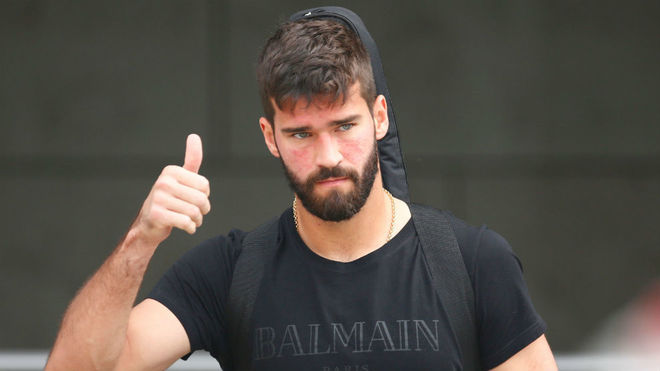 Alisson completes Liverpool move in world-record deal