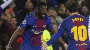 Dembele celebrates with Lionel Messi after scoring