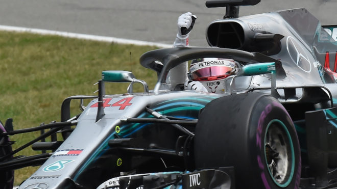 Hamilton reprimanded for pit entry miscue, keeps win
