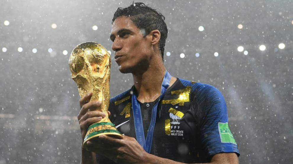 France's defender Raphael Varane holds the World Cup trophy