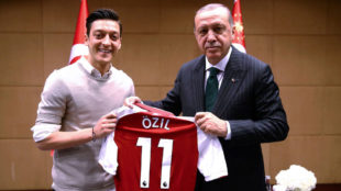 Mesut Ozil poses in a photo next to the Turkish president, Recep...