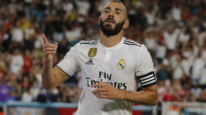 Karim Benzema reacts after scoring a goal during the match against...