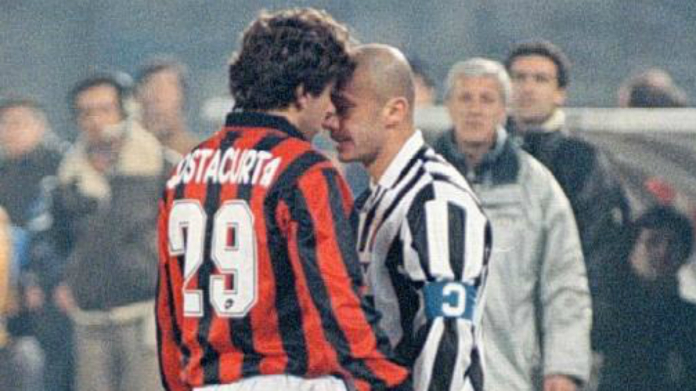 Costacurta and Viali facing each other during a game between Juventus. 1879990b26ad