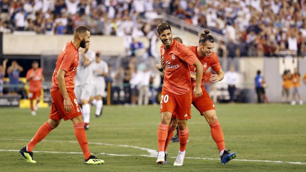 Bale, Benzema y Asensio celebran uno de los goles ante la Roma en el...