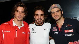 Roberto Merhi junto a Fernando Alonso