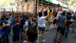 Boca fans dance on the street outside their team's Barcelona hotel
