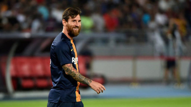 Messi heads strong Barcelona XI against Boca Juniors