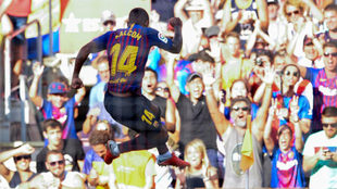 Malcom celebrates after scoring a goal during the match between...