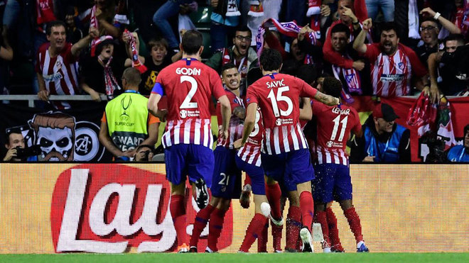 Atletico Madrid's players celebrate after scoring a goal during the...