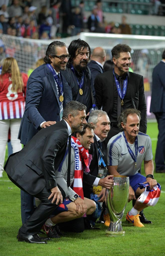 Simeone, with his coaching staff.
