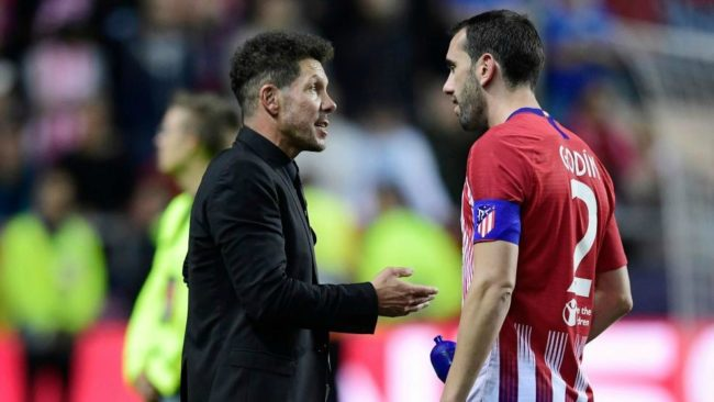 Simeone speaks to  Diego Godin at the end of the UEFA Super Cup match...