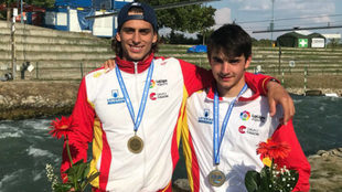 Miquel Travé y David Llorente con sus medallas.