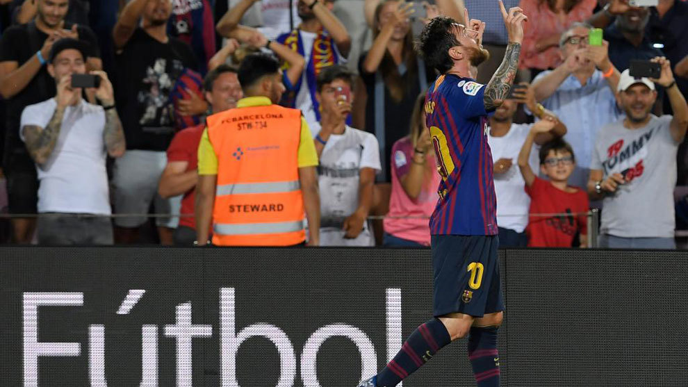 Messi celebrates after scoring a goal during the Spanish league...