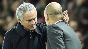United's manager Jose Mourinho shakes hands with City's...