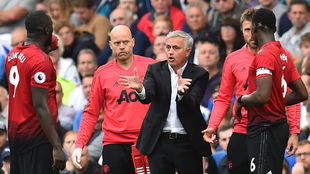 United's Portuguese manager Jose Mourinho gestures as he talks...