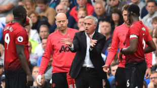 United's Portuguese manager Jose Mourinho gestures as he talks with...