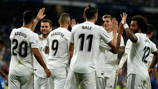 Real's Welsh forward Gareth Bale celebrates with teammates after...