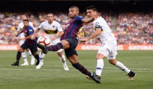 Paolo Goltz challenges Barcelona's midfielder Rafinha during the Joan...
