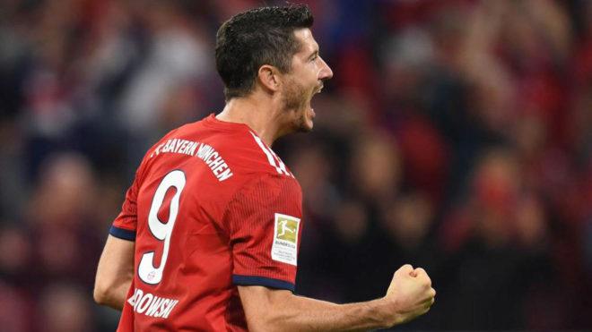 Bayern Munich's Polish forward Robert Lewandowski celebrates scoring a...