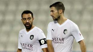 Xavi y Gabi, durante un partido con Al Sadd