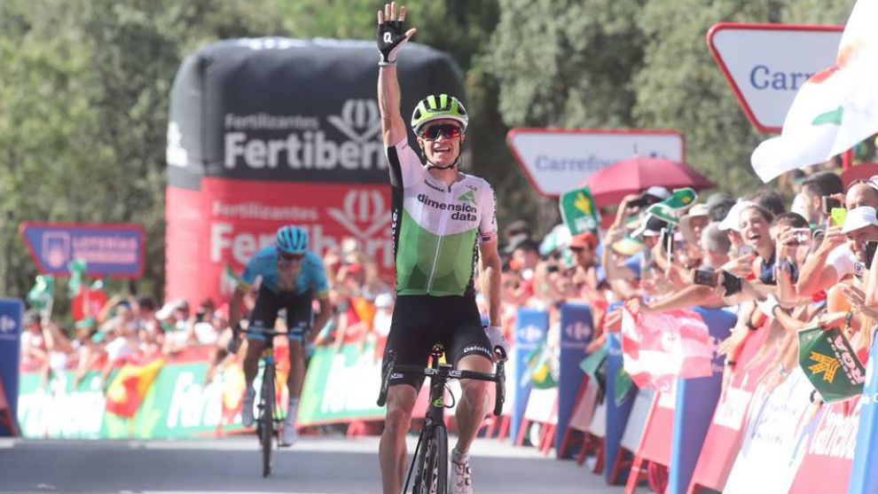 Benjamin King celebrates as he crosses the finish line winning the...