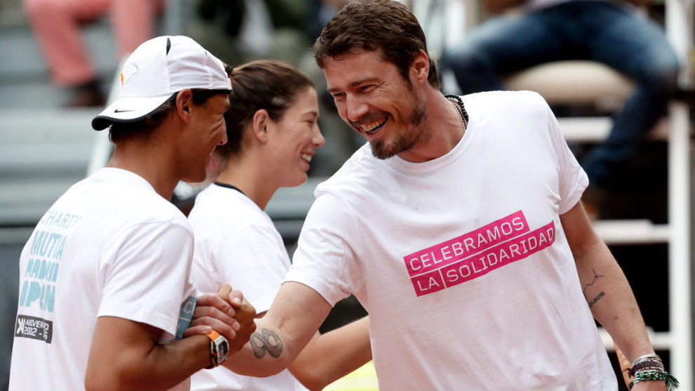Nadal and Safin greet at a charity event