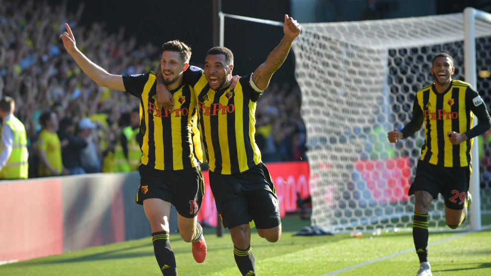 Craig Cathcart celebrates with Watford's English striker Troy Deeney