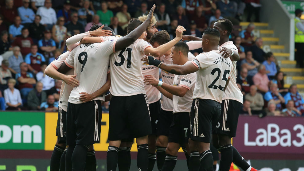 United's Belgian striker Romelu Lukaku celebrates with teammates after...