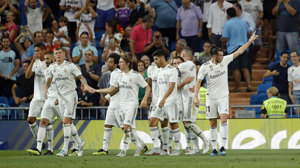 Real Madrid players celebrate a goal.
